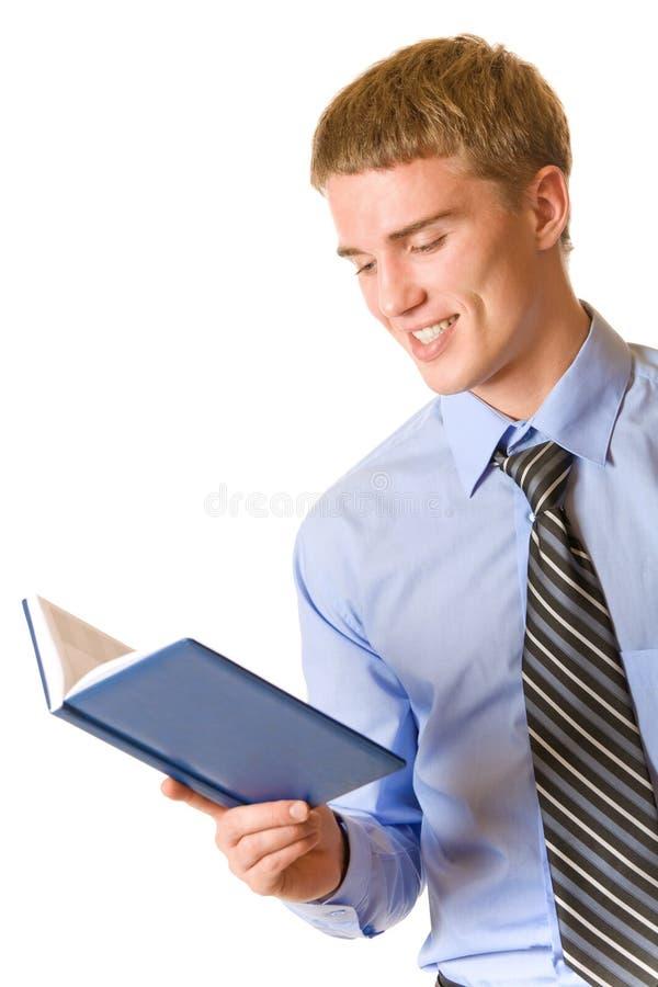 notepad czytanie biznesmena zdjęcie stock