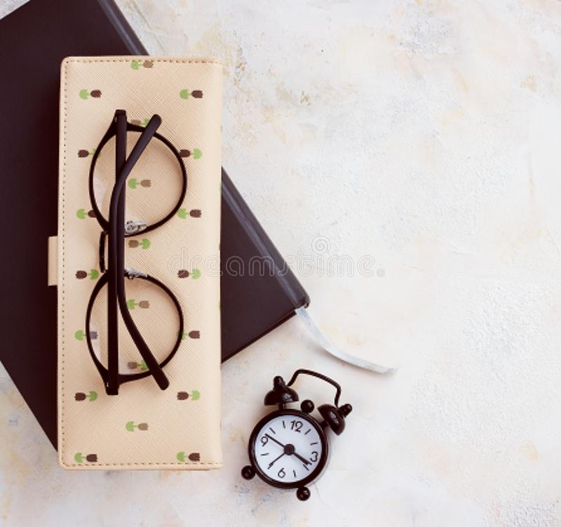 Notepad diary business card glasses clock on a light table top download notepad diary business card glasses clock on a light table top reheart Image collections