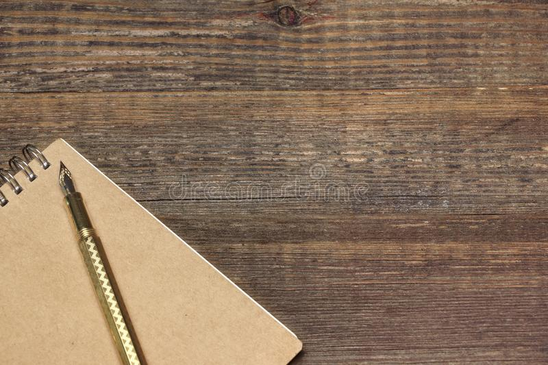 Download Notepad With Gold Fountain Pen On The Old Wood Table Stock Image    Image Of