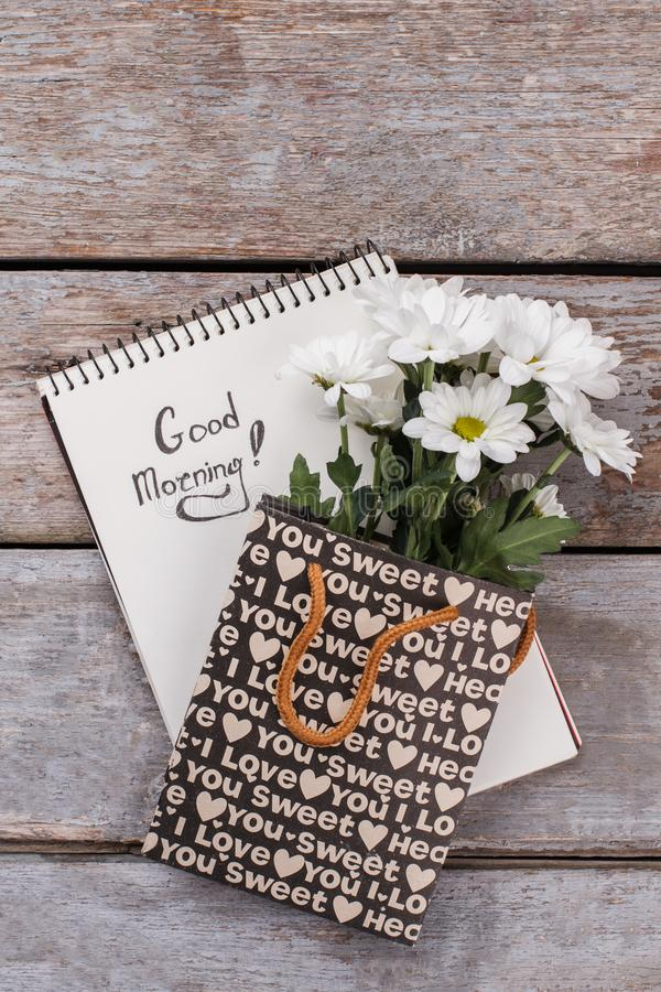 Notepad with good morning wish and flowers. royalty free stock photos
