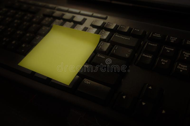 Notepad with Keyboard and Memo. Notepad: a pad of blank or ruled pages for writing notes on. keyboard: a panel of keys that operate a computer or typewriter stock photo
