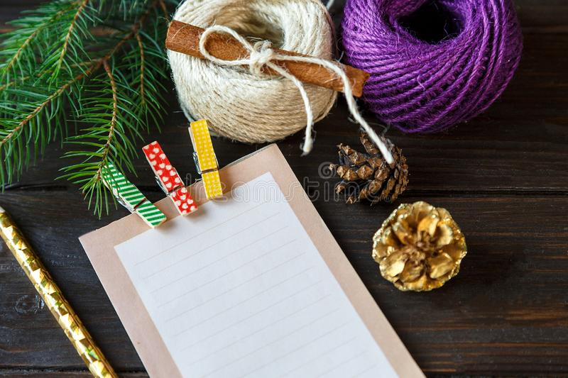 Notepad lays on the wooden background to make a list to do things or list of presents for friends and family. New year. And Christmas concept. close up royalty free stock photography