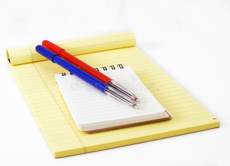 Notepad and memo. Notepad and ball-point pen royalty free stock photo