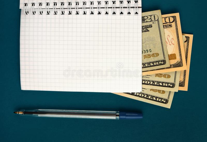 Notepad with a Money. Writing Pad with a Money on the Green Paper closeup royalty free stock images