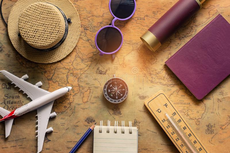 Notepad for note with passport, binoculars, pencil, compass, airplane on paper map for travel adventure discovery image royalty free stock photo