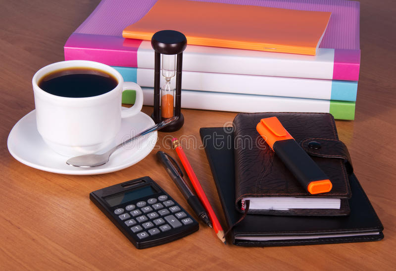 Notepad, notebook, organizer, label, document folders, calculator, coffee on esktop. royalty free stock photos