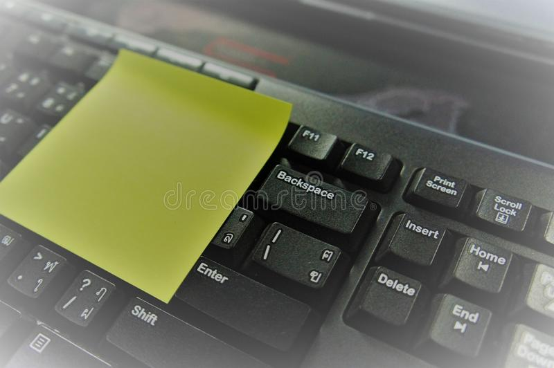 Notepad with Keyboard and Memo. Notepad: a pad of blank or ruled pages for writing notes on. keyboard: a panel of keys that operate a computer or typewriter royalty free stock images
