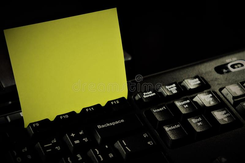 Notepad with Keyboard and Memo. Notepad: a pad of blank or ruled pages for writing notes on. keyboard: a panel of keys that operate a computer or typewriter stock image