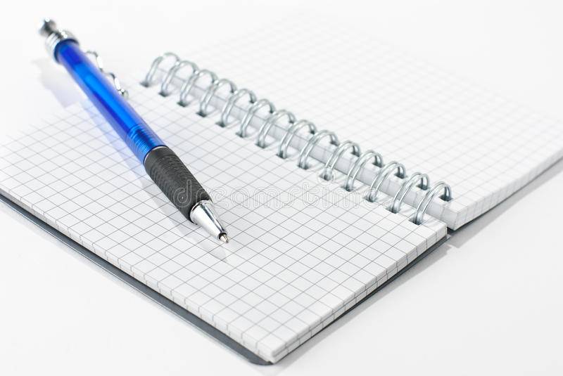 Notepad and a pen royalty free stock photo