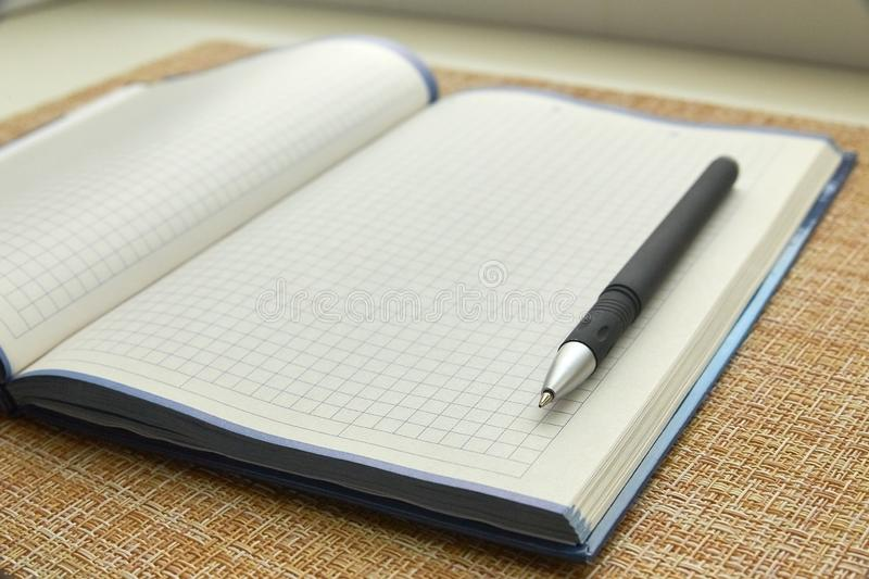 Notepad and pen. Blank sheet of paper. Business, office. stock image