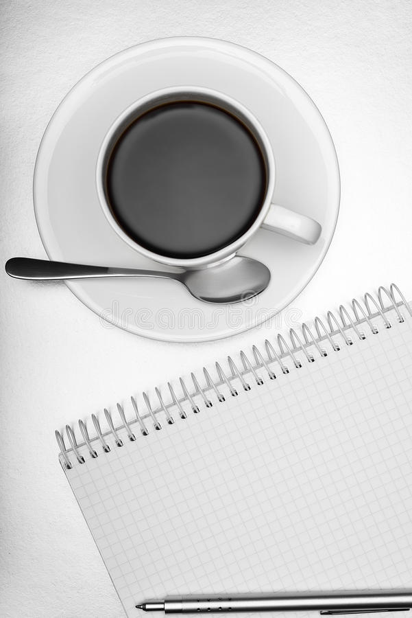 Notepad, pen and cup of coffee stock photography
