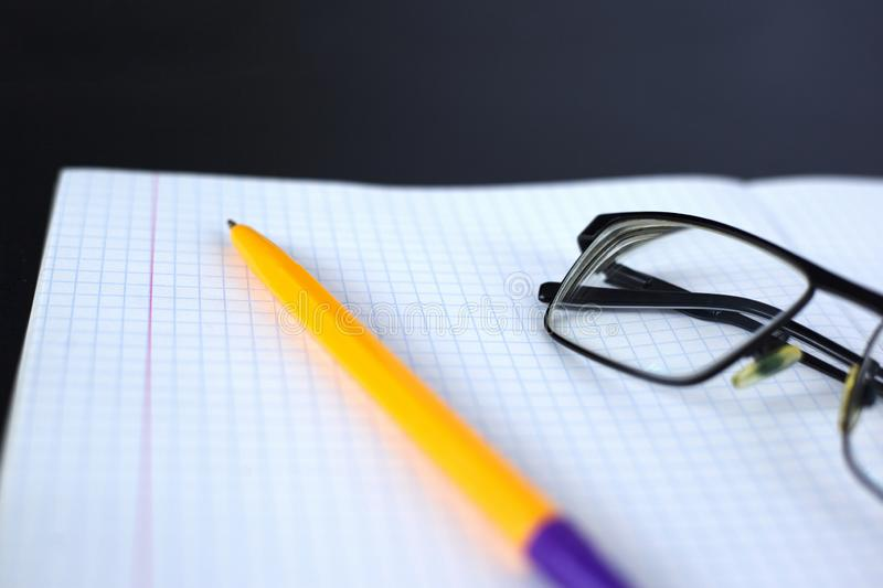 Notepad, pen and glasses. start over with a clean slate. Concept from scratch stock photos