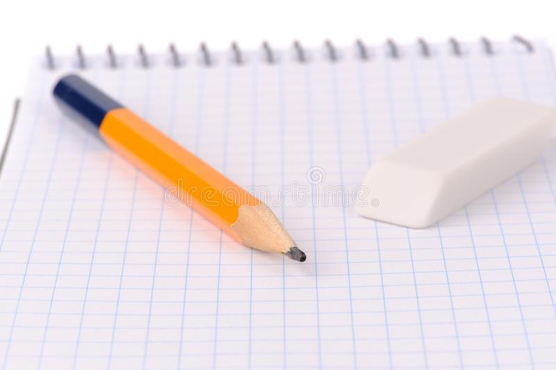 Notepad with pencil and eraser stock photo