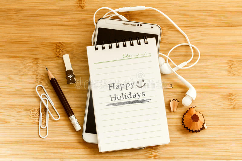 Notepad with pencil and smart phone on wooden table for happy h stock photos