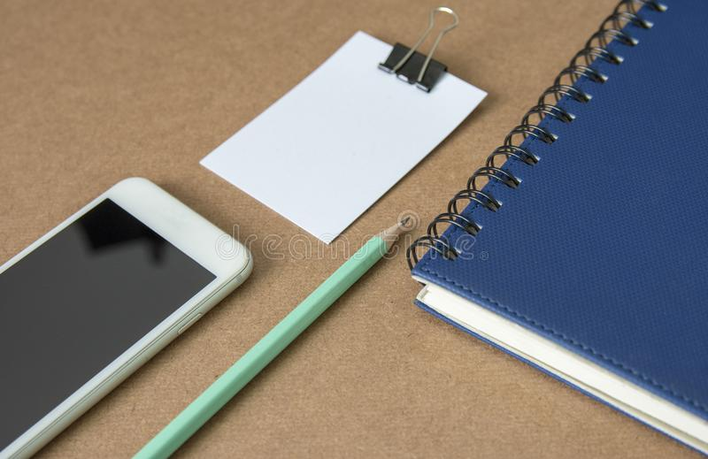 Notepad with pencil on wood board background. stock photography