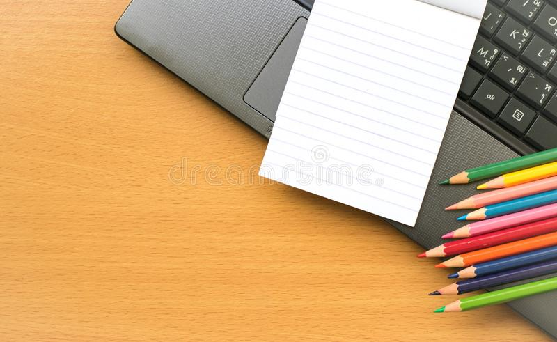 Notepad with pencil on wood board background. using wallpaper or background for education, business photo. Take note of the produc. T for book with paper and stock images