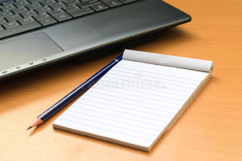 Notepad with pencil on wood board background. using wallpaper or background for education, business photo. Take note of the produc. T for book with paper and stock image
