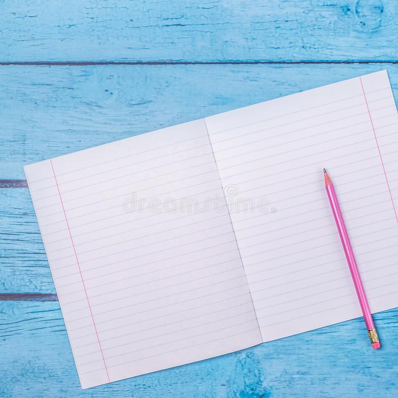 Notepad with pencil on wood board background.using wallpaper for education, business photo.Take note of the product for book with royalty free stock images