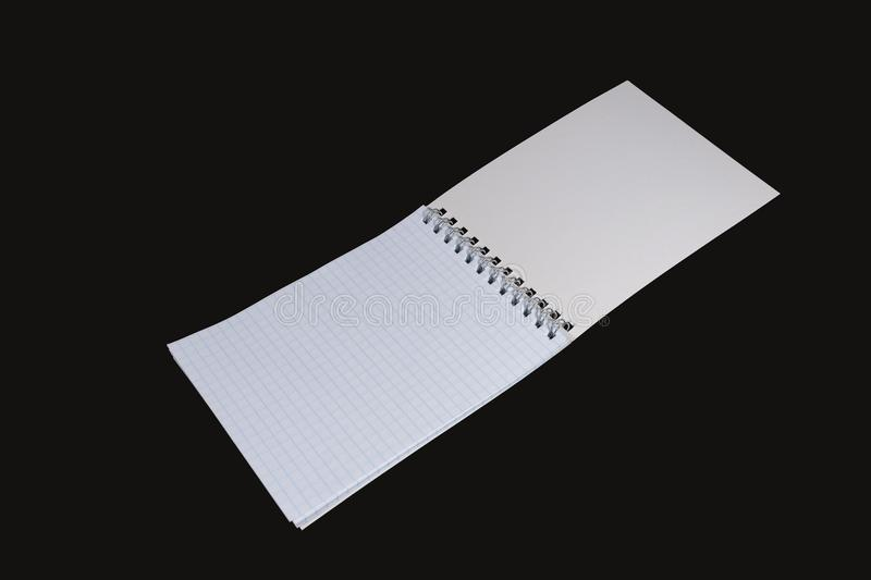 Notepad sheet. Isolated. On a black background royalty free stock photography