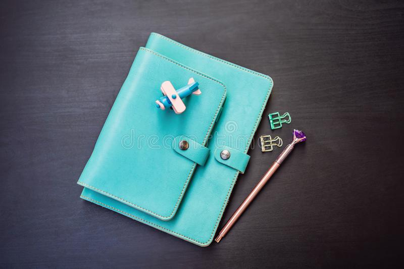 Notepad and stationery on a black background. Planner for business and study. Fans of stationery.  stock photo