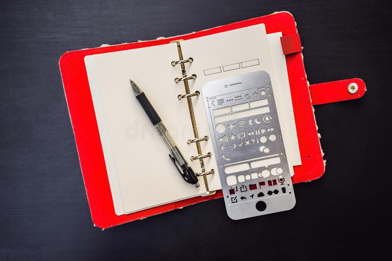 Notepad and stationery on a black background. Planner for business and study. Fans of stationery.  stock photos