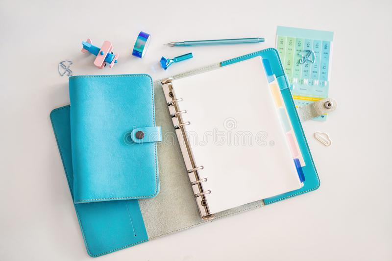 Notepad and stationery on white background. Planner for business and study. Fans of stationery.  stock photography