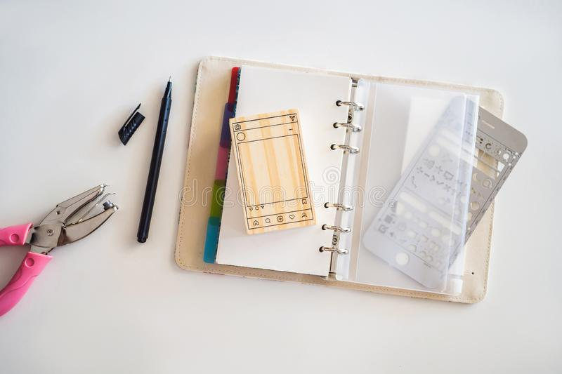 Notepad and stationery on white background. Planner for business and study. Fans of stationery.  stock photos
