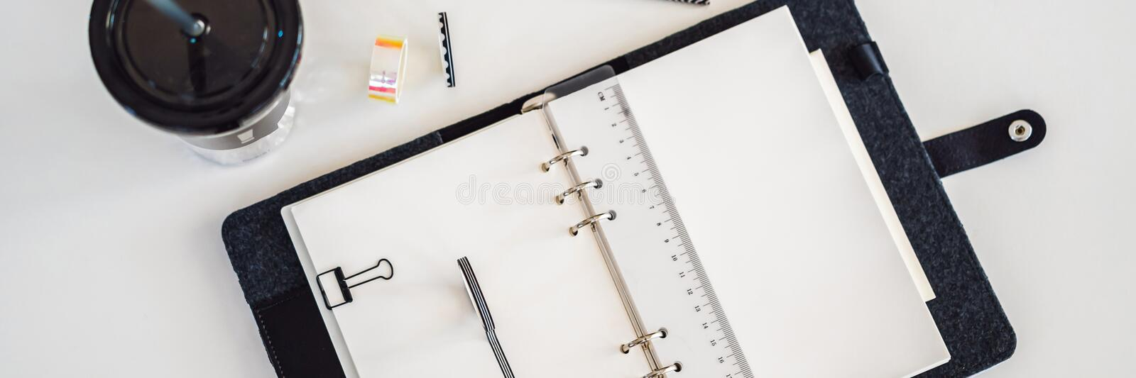 Notepad and stationery on white background. Planner for business and study. Fans of stationery BANNER, LONG FORMAT. Notepad and stationery on white background royalty free stock photos