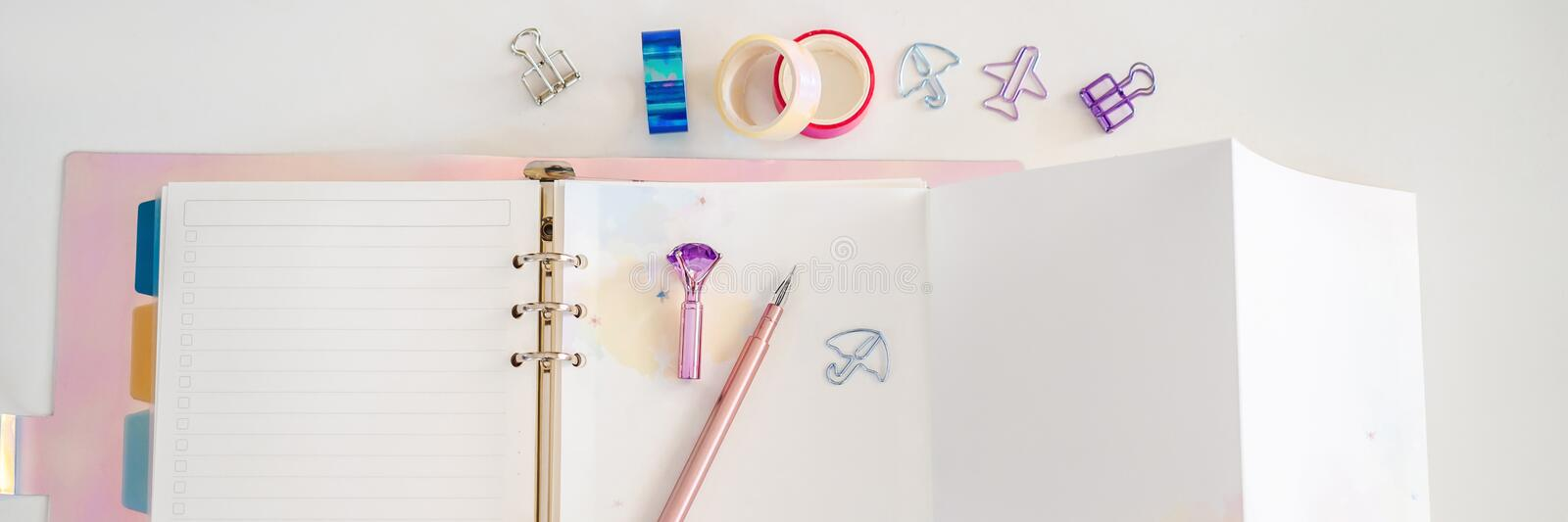 Notepad and stationery on white background. Planner for business and study. Fans of stationery BANNER, LONG FORMAT. Notepad and stationery on white background stock image