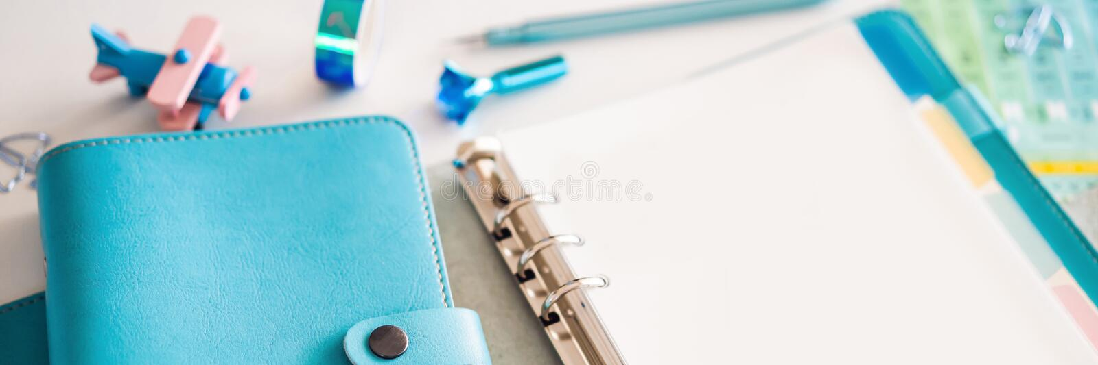 Notepad and stationery on white background. Planner for business and study. Fans of stationery BANNER, LONG FORMAT. Notepad and stationery on white background royalty free stock image