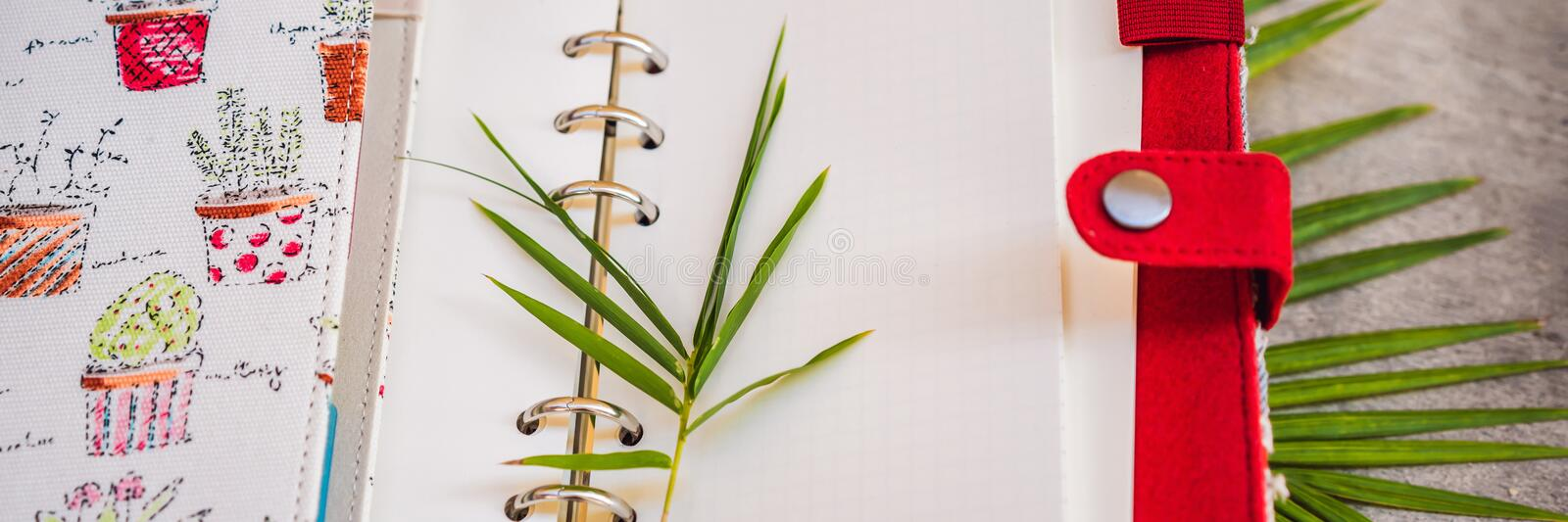 Notepad and stationery on wooden background. Planner for business and study. Fans of stationery BANNER, LONG FORMAT. Notepad and stationery on wooden background royalty free stock photo