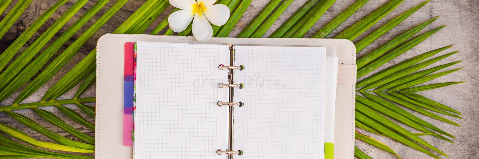 Notepad and stationery on wooden background. Planner for business and study. Fans of stationery BANNER, LONG FORMAT. Notepad and stationery on wooden background stock photography