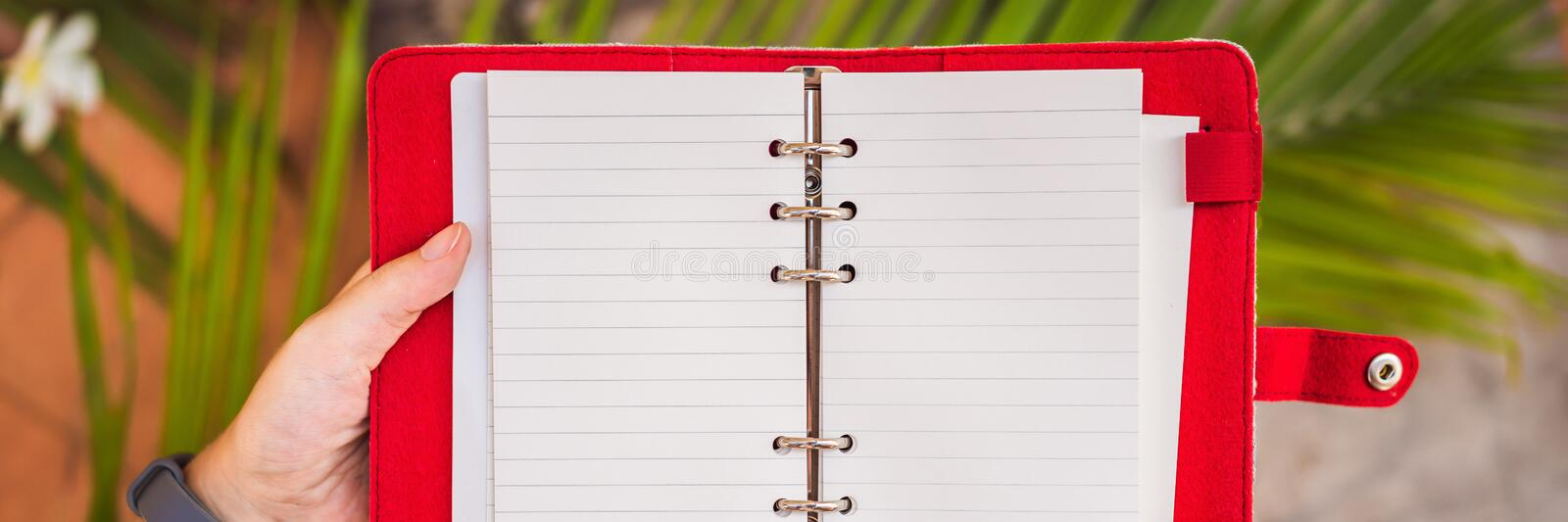 Notepad and stationery on wooden background. Planner for business and study. Fans of stationery BANNER, LONG FORMAT. Notepad and stationery on wooden background stock photo