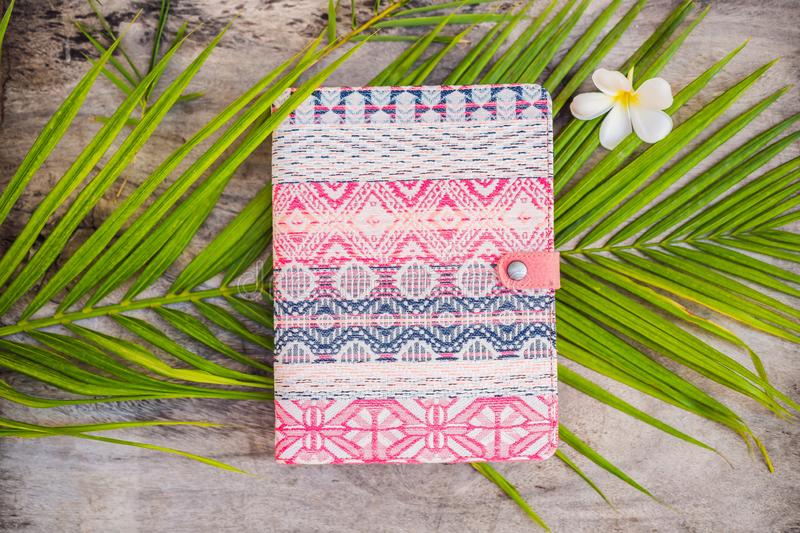 Notepad and stationery on wooden background. Planner for business and study. Fans of stationery.  stock photo