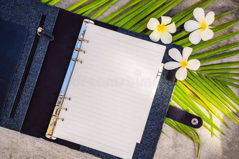 Notepad and stationery on wooden background. Planner for business and study. Fans of stationery. Travel planning. Notebook. Travel concept royalty free stock image