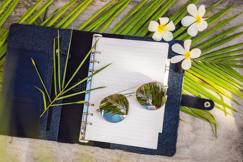 Notepad and stationery on wooden background. Planner for business and study. Fans of stationery. Travel planning. Notebook. Travel concept stock image