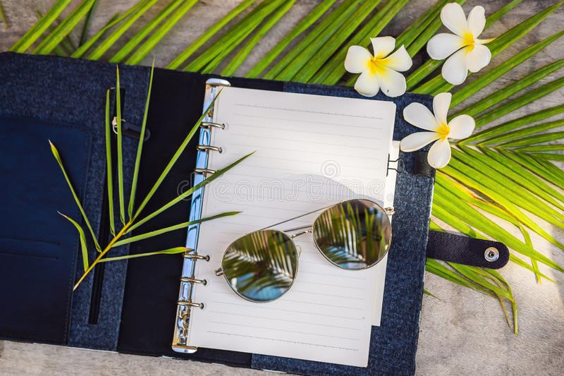 Notepad and stationery on wooden background. Planner for business and study. Fans of stationery. Travel planning. Notebook. Travel concept stock photography