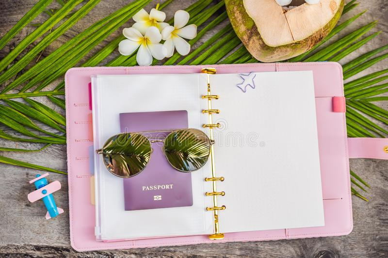 Notepad and stationery on wooden background. Planner for business and study. Fans of stationery. Travel planning. Notebook. Travel concept royalty free stock photo