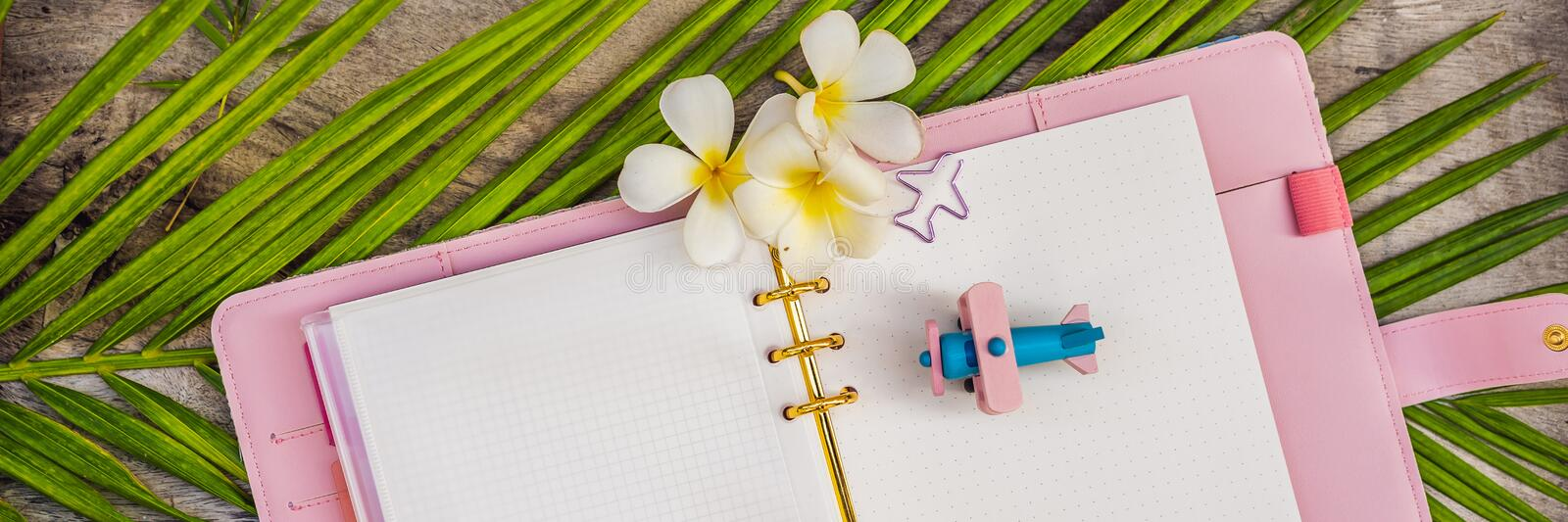 Notepad and stationery on wooden background. Planner for business and study. Fans of stationery. Travel planning. Notebook. Travel concept. BANNER, LONG FORMAT stock photos