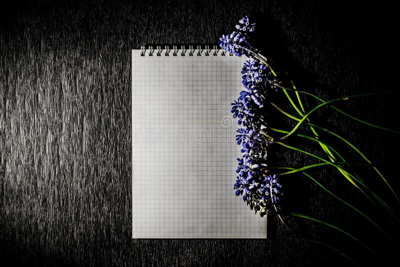 Notepad with wild flowers stock image