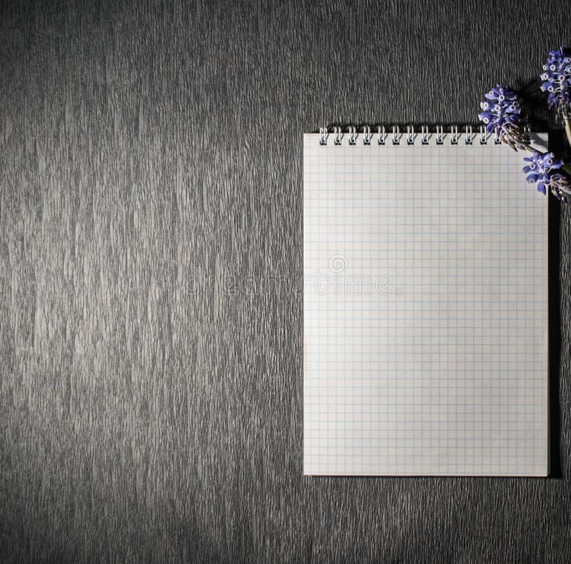 Notepad with wild flowers stock photos