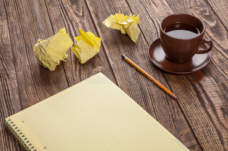 Notepad on a wooden table royalty free stock photos