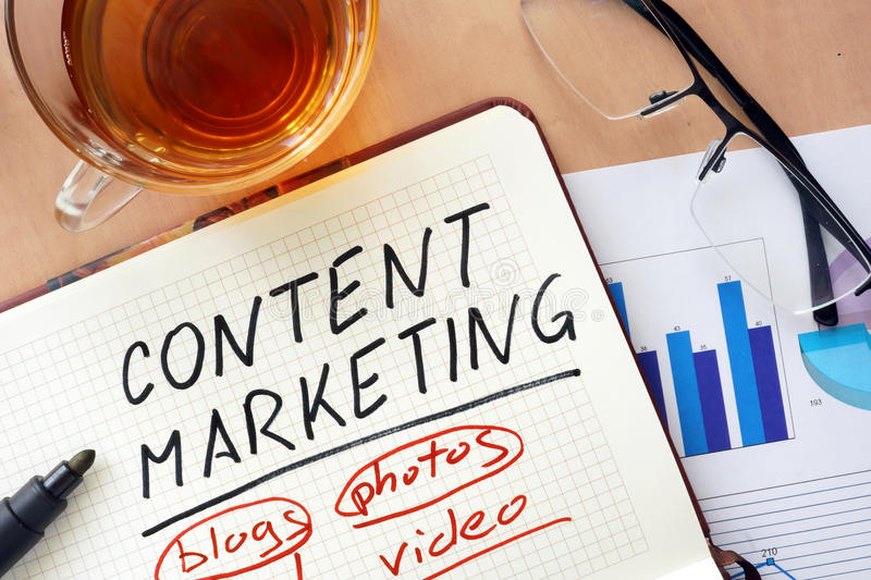 Notepad with word content marketing concept. And marker stock photo