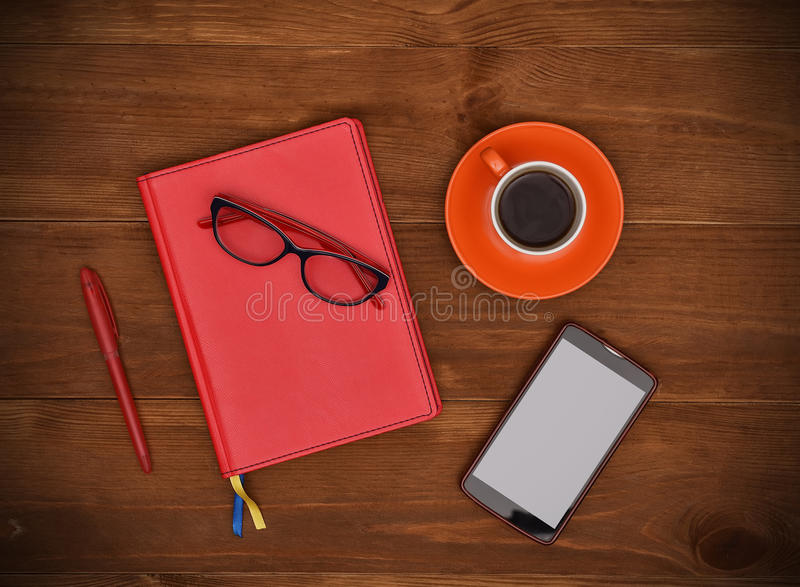 Notepads, coffee cup and smartphone royalty free stock photos