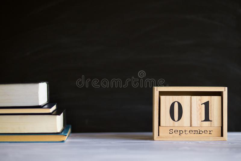 Notepads on table in front of chalk board. Back to school concept. With copy space royalty free stock photography
