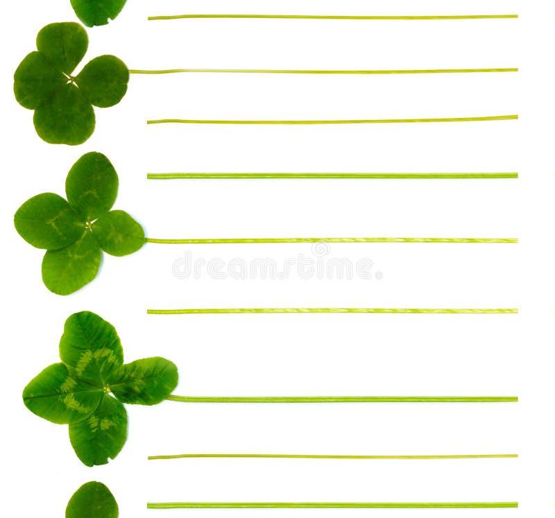 Notepadsida av fyrklöver För lista av fall plan, idé royaltyfria bilder