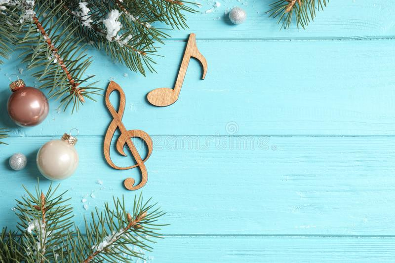 Notes on blue wooden , flat lay with space for text. Christmas music concept. Notes on blue wooden background, flat lay with space for text. Christmas music royalty free stock image