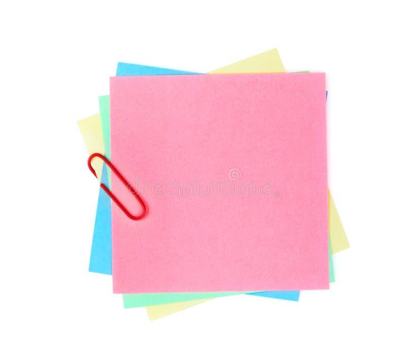Notes de post-it colorées avec l'agrafe image stock