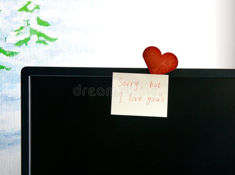 Notes et carte d'amour sur l'écran images libres de droits