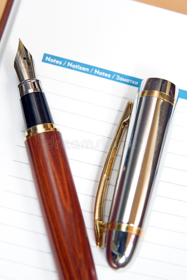 Notes and pen. Blanks notes and fountain pencil royalty free stock images
